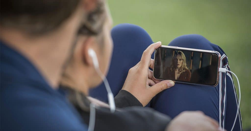 Watching a course video on a mobile phone